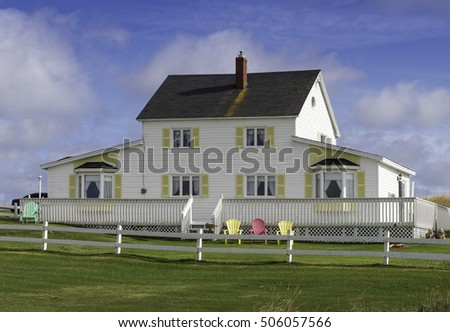 White house with yellow shutters