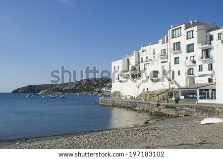 White houses near the beach and the sea, in a coastal landscape, in Cadaques (Costa Brava) Girona - Spain - stock photo