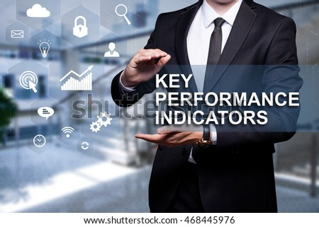 "White icon with text ""Key Performance Indicator "" in the hands of a businessman. Business concept. Internet concept."
