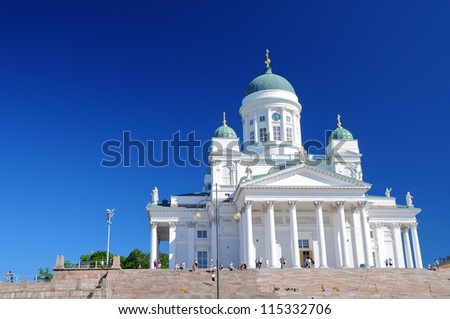 White iconic cathedral in Helsinki, Finland with deep blue sky - stock photo