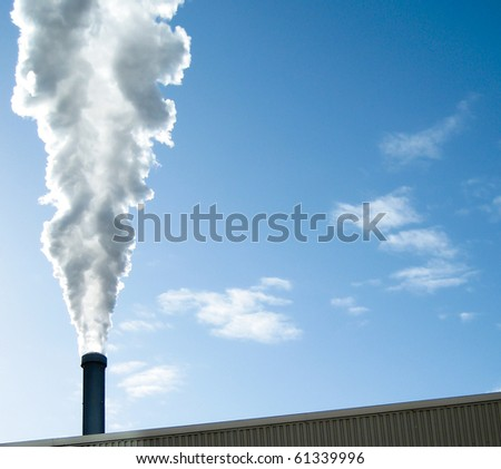 White industrial steam against blue sky - stock photo