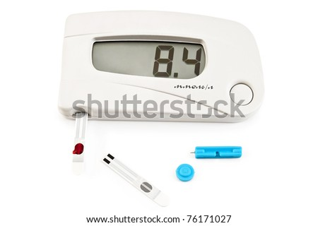 White instrument for measuring glucose levels with test strips, a drop of blood and needles isolated on a white background