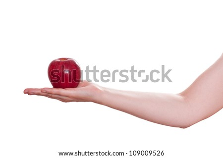 White isolated red apple of temptation in a female hand - stock photo