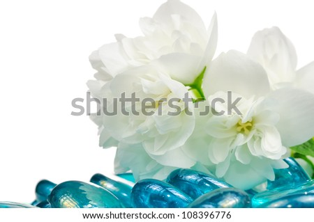 White Jasmine Flowers with Blue Glass Stones - stock photo