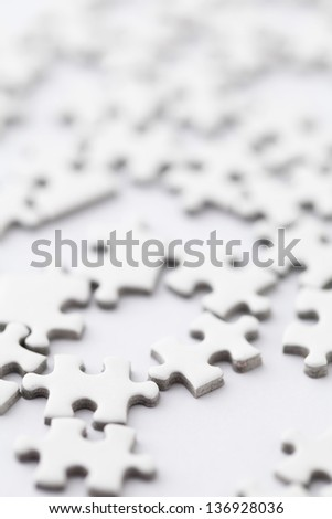 white jigsaw puzzle - stock photo