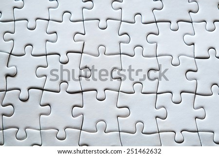White jigsaw puzzle for background or textures - stock photo