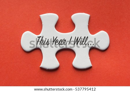 White jigsaw puzzle with a written word This Year I Will on a red background.