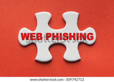 White jigsaw puzzle with a written word web phishing on a red background. - stock photo