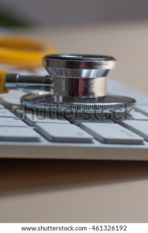 White keyboard and yellow  stethoscope