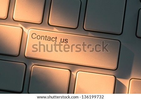 White keyboard with close up on contact us button - stock photo
