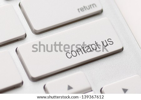 white keyboard with contact us key - stock photo