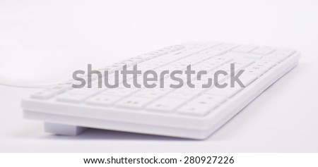 White keyboard with wire on isolated white background, different view - stock photo