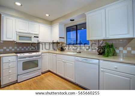 White Kitchen Design With White Shaker Cabinets Paired With Cream Quartz  Countertops And White And Beige