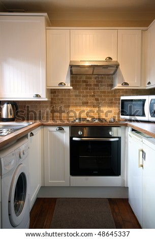 White kitchen in small UK Home vertical view - stock photo