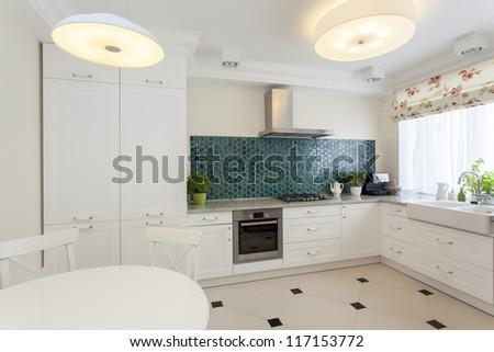 White kitchen interior with turquoise tiles - stock photo