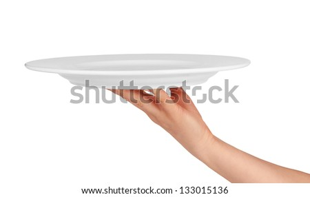 white kitchen plate on woman hand on white background - stock photo