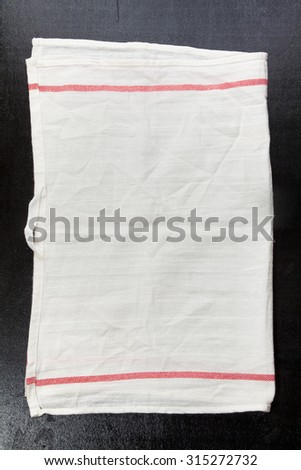 white kitchen towel on a dark background. space for writing text