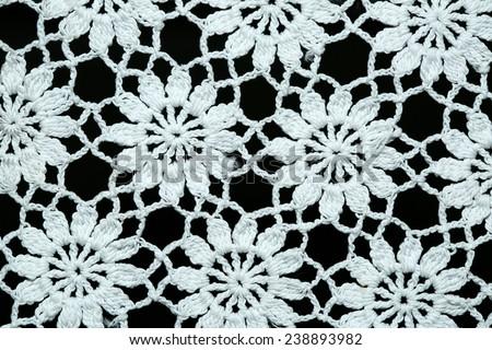 White knitting fabric texture isolated on black background - stock photo