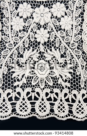 white lace on a black background - stock photo