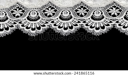 white lace on black background