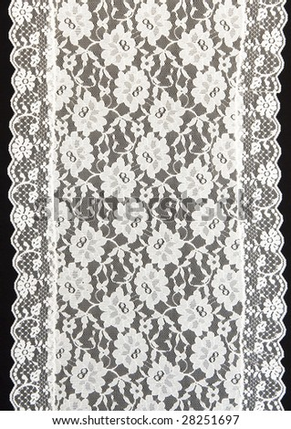 white lace with a black background - stock photo