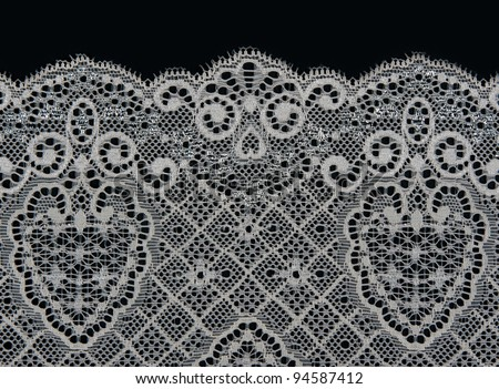 white lace with a floral pattern on a black background - stock photo