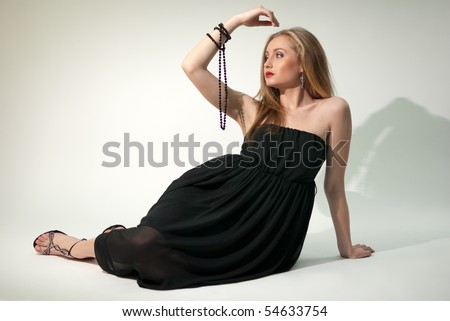 White lady in black chiffon dress with beads - stock photo