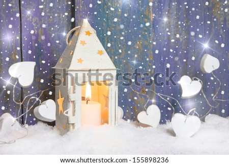 White lantern with candlelights and white hearts - stock photo