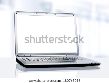 White laptop in the office. - stock photo