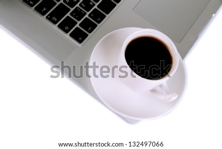 White laptop with cup of coffee close-up isolated on white - stock photo