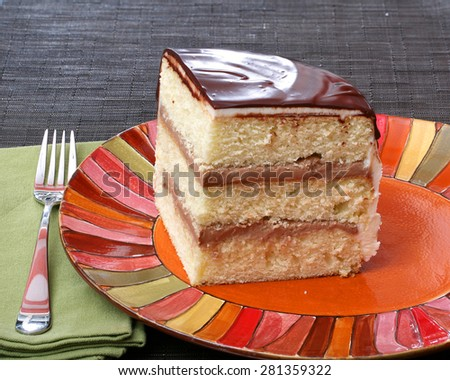 White layer cake with chocolate filling and chocolate ganache plus ...