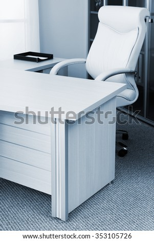 white leather armchair in a modern office - stock photo