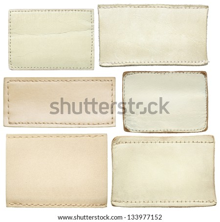 White leather jeans labels, leather tags. - stock photo