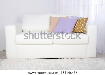White leather sofa in room - stock photo