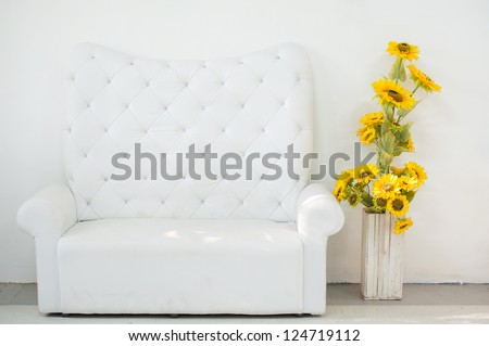 White leather sofa in the room - stock photo