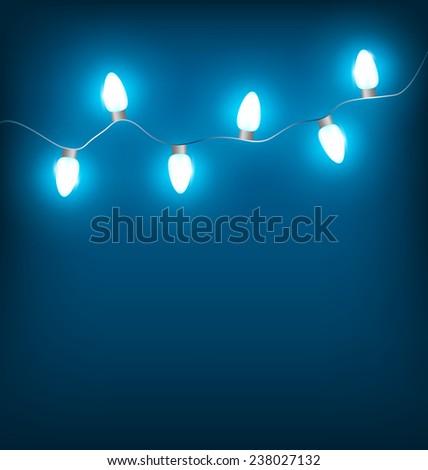 White led Christmas lights garland on blue background - stock photo