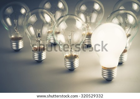 White light bulb glowing among the others - stock photo