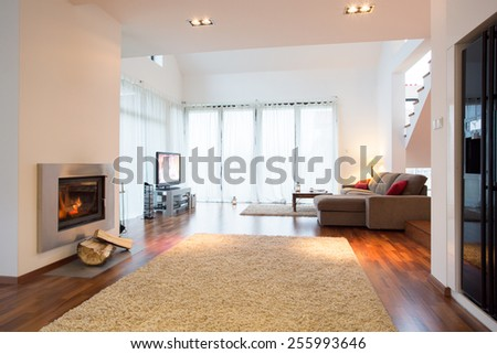 White light living room with fireplace in residence - stock photo