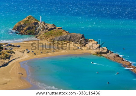 White lighthouse, location - Castlepoint, North Island, New Zealand - stock photo