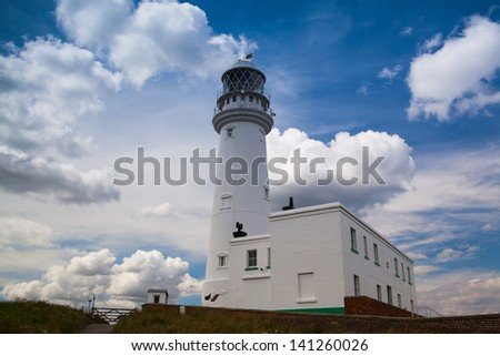 White lighthouse on Flamborough Head in England