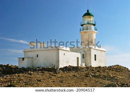 White lighthouse on the background of blue sky