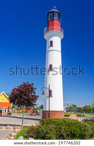White lighthouse over blue sky