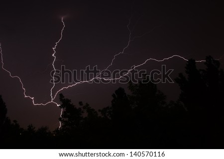 White lightning during summer storm at night  - stock photo