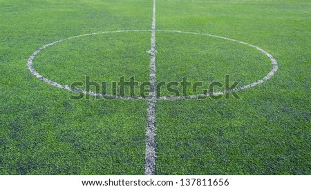 white lines in green grass field in the soccer field - stock photo