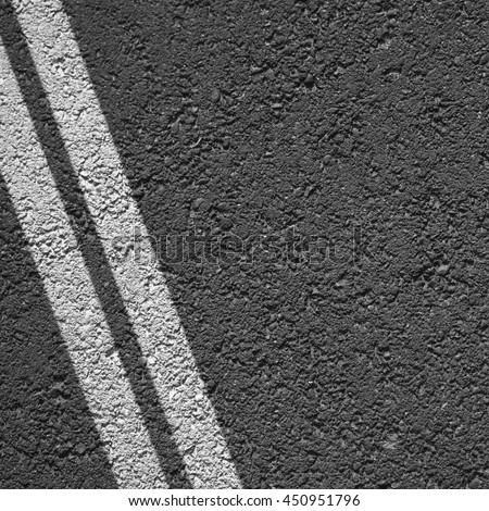 White lines over the asphalt road - stock photo