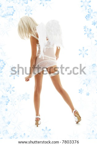 white lingerie angel girl on high heels with snowflakes - stock photo