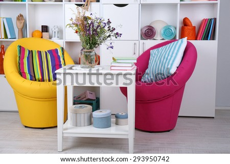 White living room with armchairs and bookcase - stock photo