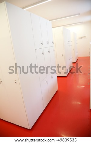 White lockers on red floor - stock photo