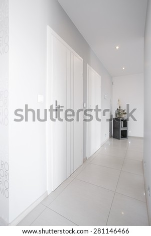 White long corridor with shining marble floor  - stock photo