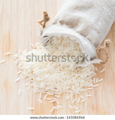 White long rice in small burlap sack - stock photo